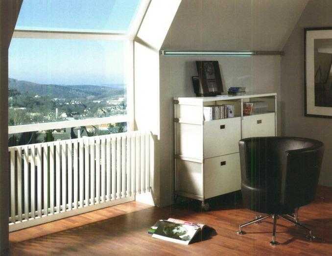 Трубчатые радиаторы можно использовать как перила для ограждения стекол и лестничных