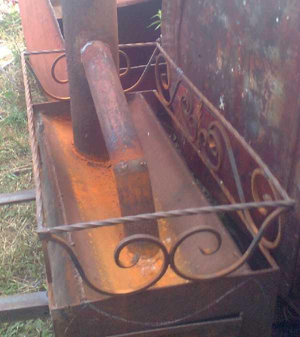 Печь из трубы с открытой каменкой, сделанная умельцем